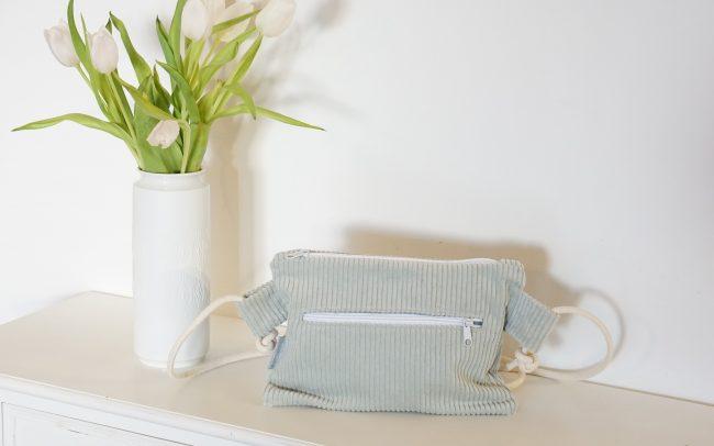Handtasche Clutch Breitcord Mineral grün hellgrün Pastell Kordel beige weißer Reißverschluss